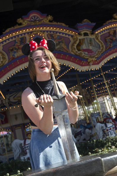 Game of Thrones star Maisie Williams (aka the plucky Arya Stark) tries her hand at pulling the sword from the stone at Walt Disney World.