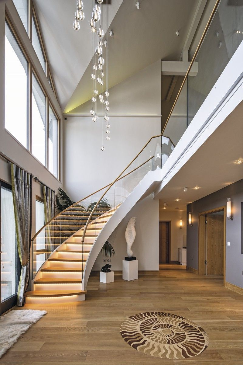 Double-height entrance and sweeping staircase makes for ...