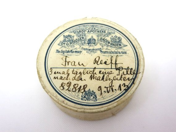 A beautiful antique paper apothecary or pharmacists paper pill box, featuring a pretty label with blue print. There is a prescription written in