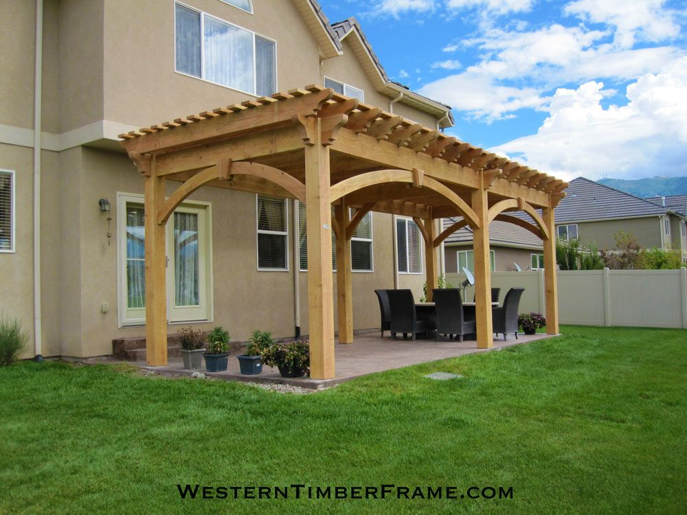 Timber Framed Free Standing Mortise And Tenon Dovetailed Pergola Over The  Back Patio.