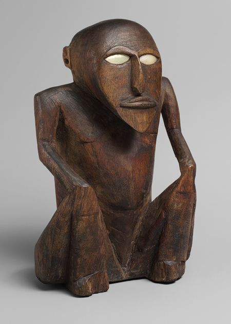 Metmuseum | Seated Figure [Satawan Island, Caroline Islands] (2003.8) | Heilbrunn Timeline of Art History | The Metropolitan Museum of Art | Wood, shell, traces of paint and resin; H. 21 cm