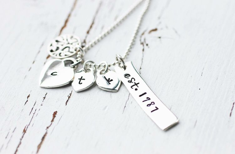 Sterling Silver Hand Stamped Family Necklace with a family tree charm , hand stamped initial hearts and a hand stamped date bar. Order one today at www.Facebook.com/CoreyTreacyDesigns.com