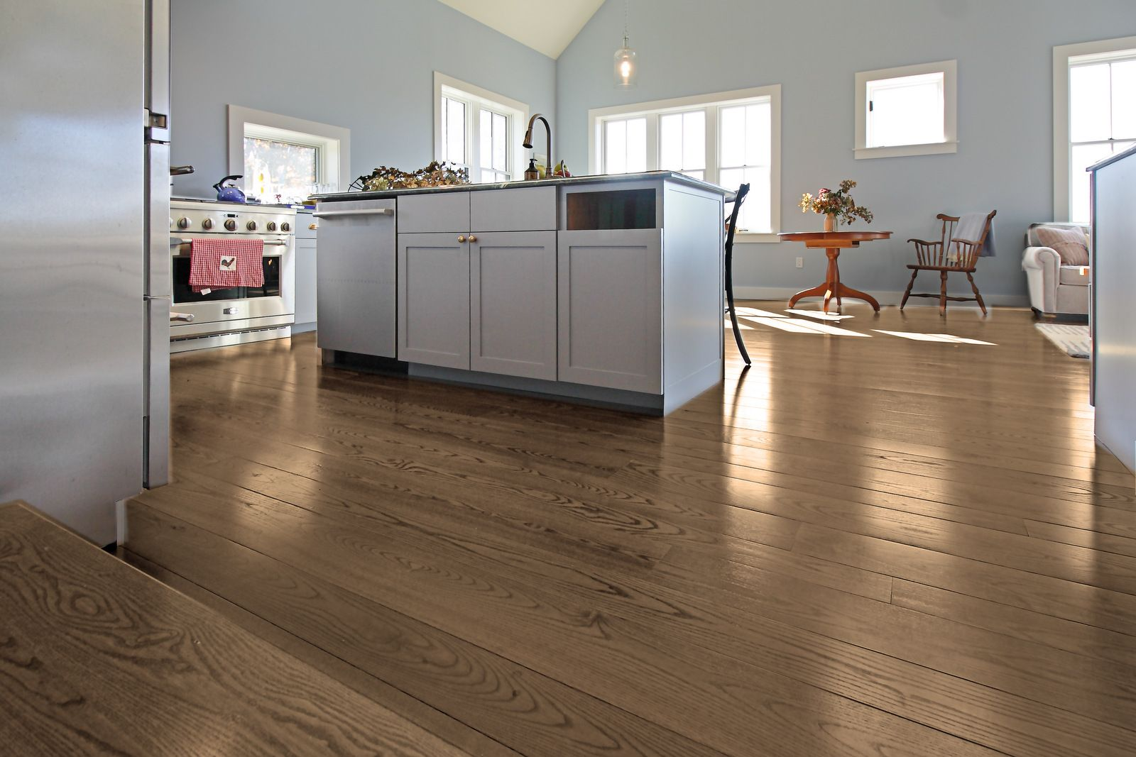 Ash plank flooring makes a durable kitchen floor