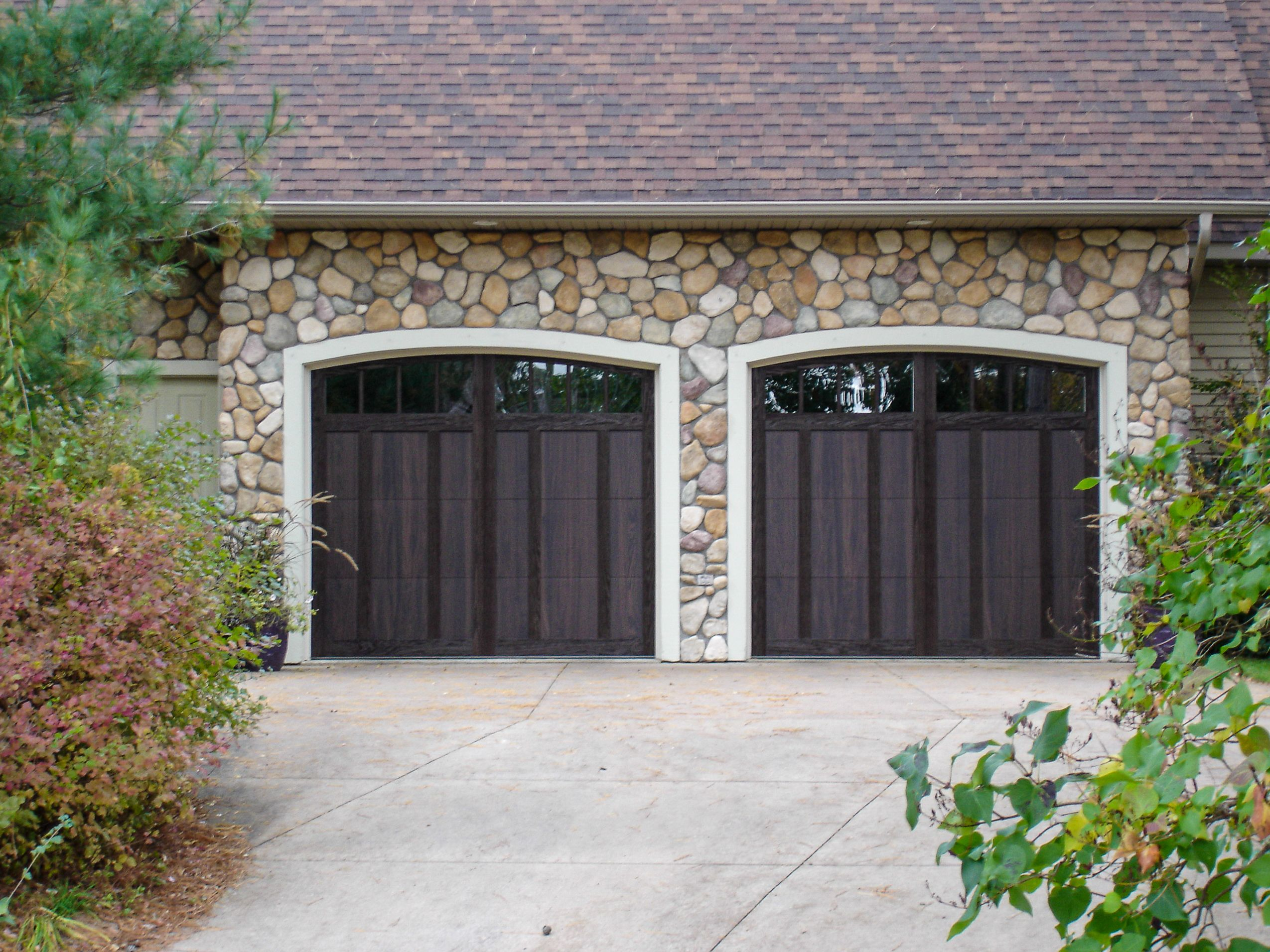 Shoreline Overlay Garage Doors In Walnut Accents Woodtones By C H I Overhead Doors Garage Door Styles Garage Doors Garage Door Design