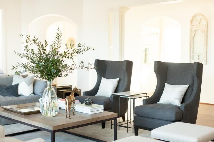 Stunning Living Room Features A Pair Of Gray Wingback Chairs