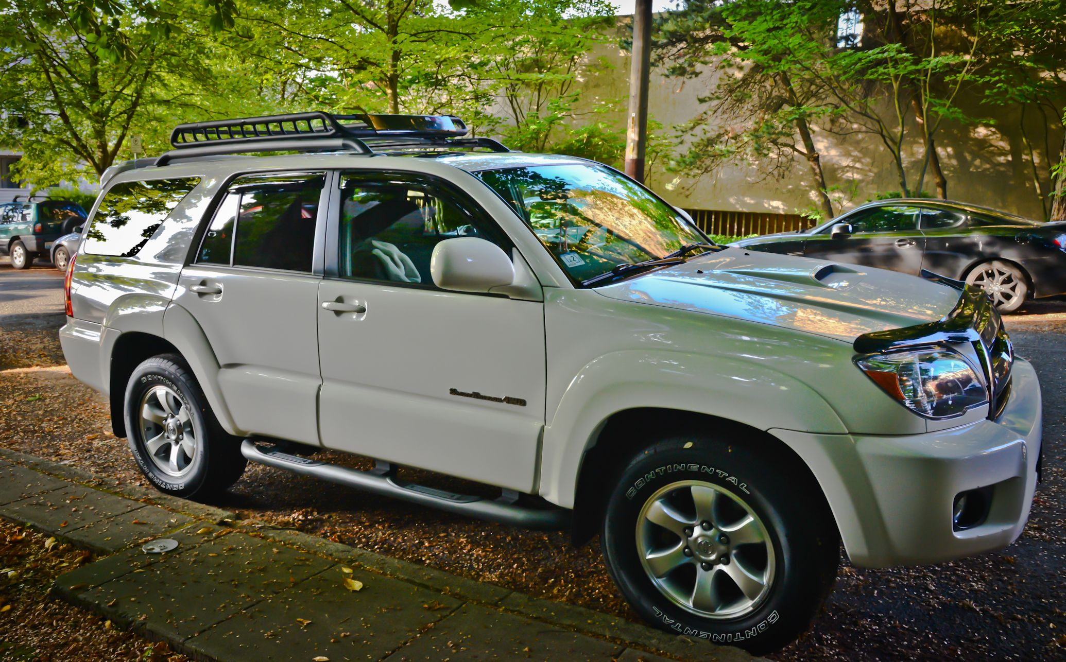 2007 4Runner with tube steps and a rugged roof rack basket