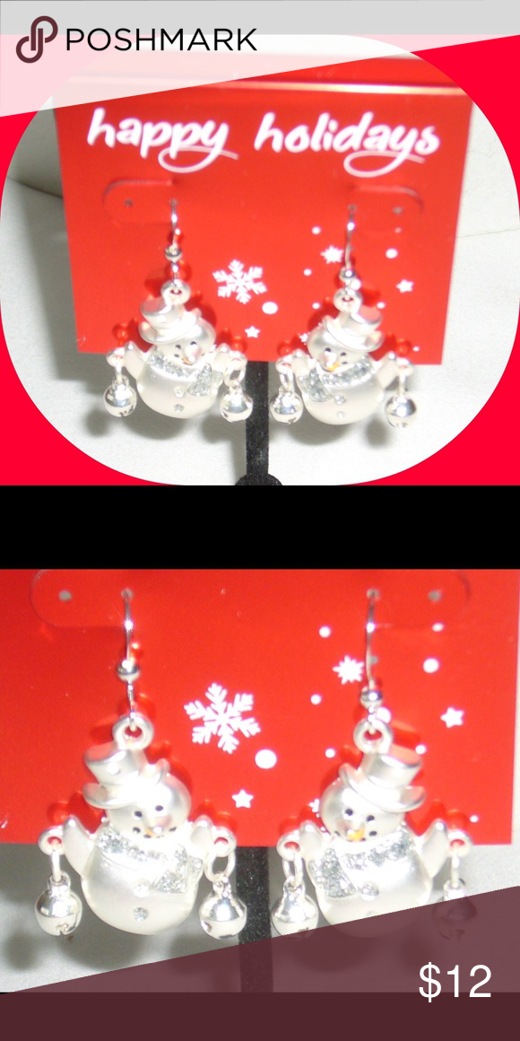 ☃️Snowman & Bell Drop Earrings Cute Christmas snowman and Bell drop earrings are the finishing touch for Christmas. Can be worn fancy or casual you decide. Each adorable snowman is holding one Silvertone jingle bell in each hand. Neck scarf has clear rhinestones. Black painted eyes an mouth with a carrot orange nose. Silvertone metal, frosted, brushed finish. Drop earrings. Pierced fish hooks. Imported. Comes in white box. Gift wrap available or free gift bag upon request. NWT (2 in…