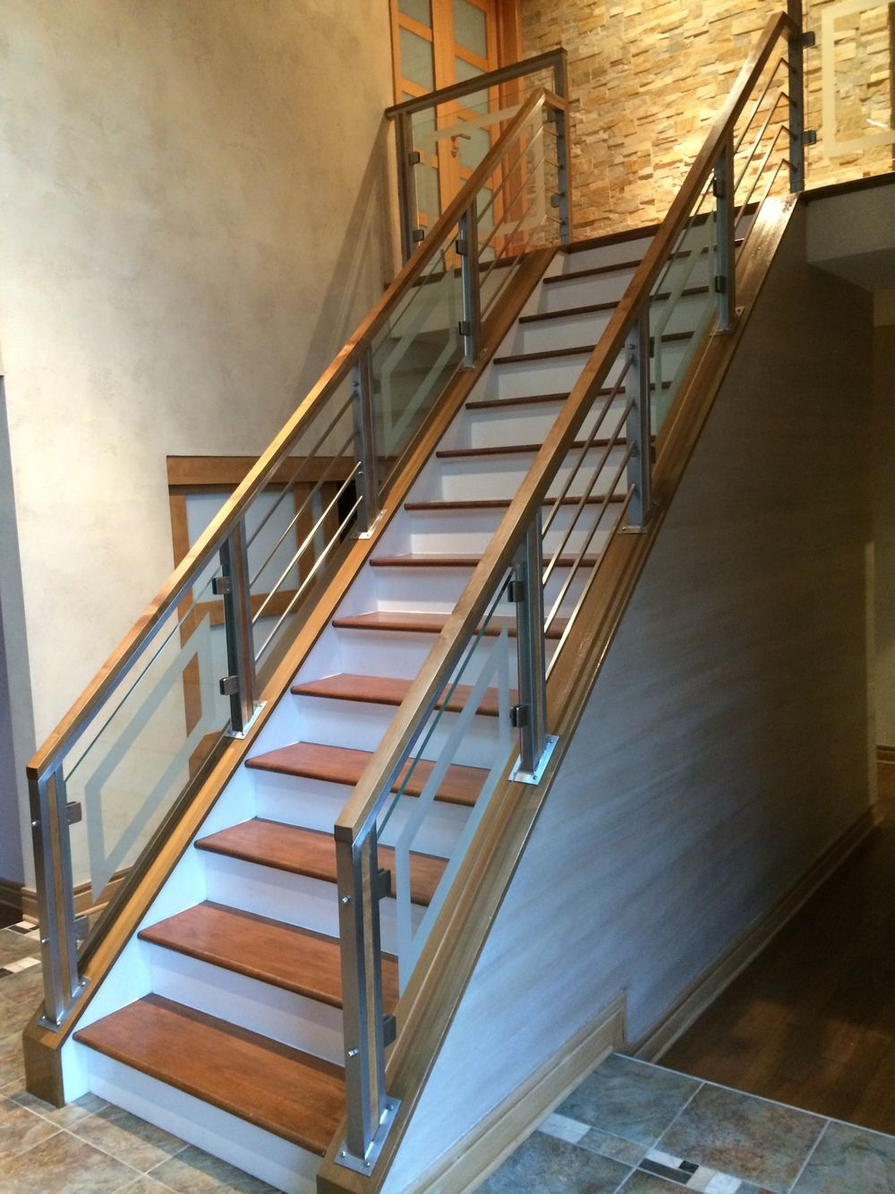 Stainless steel horizontal rods and glass railing with ...