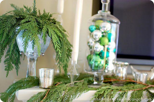 Evergreen transforms any mantel to seasonally chic.
