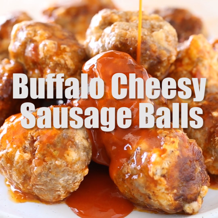 This easy four ingredient recipe for the best Crock Pot Buffalo Cheesy Sausage Balls are the perfect party appetizer for Super Bowl, holidays, tailgate food or anytime! They're also gluten free and low carb! #tailgatefood