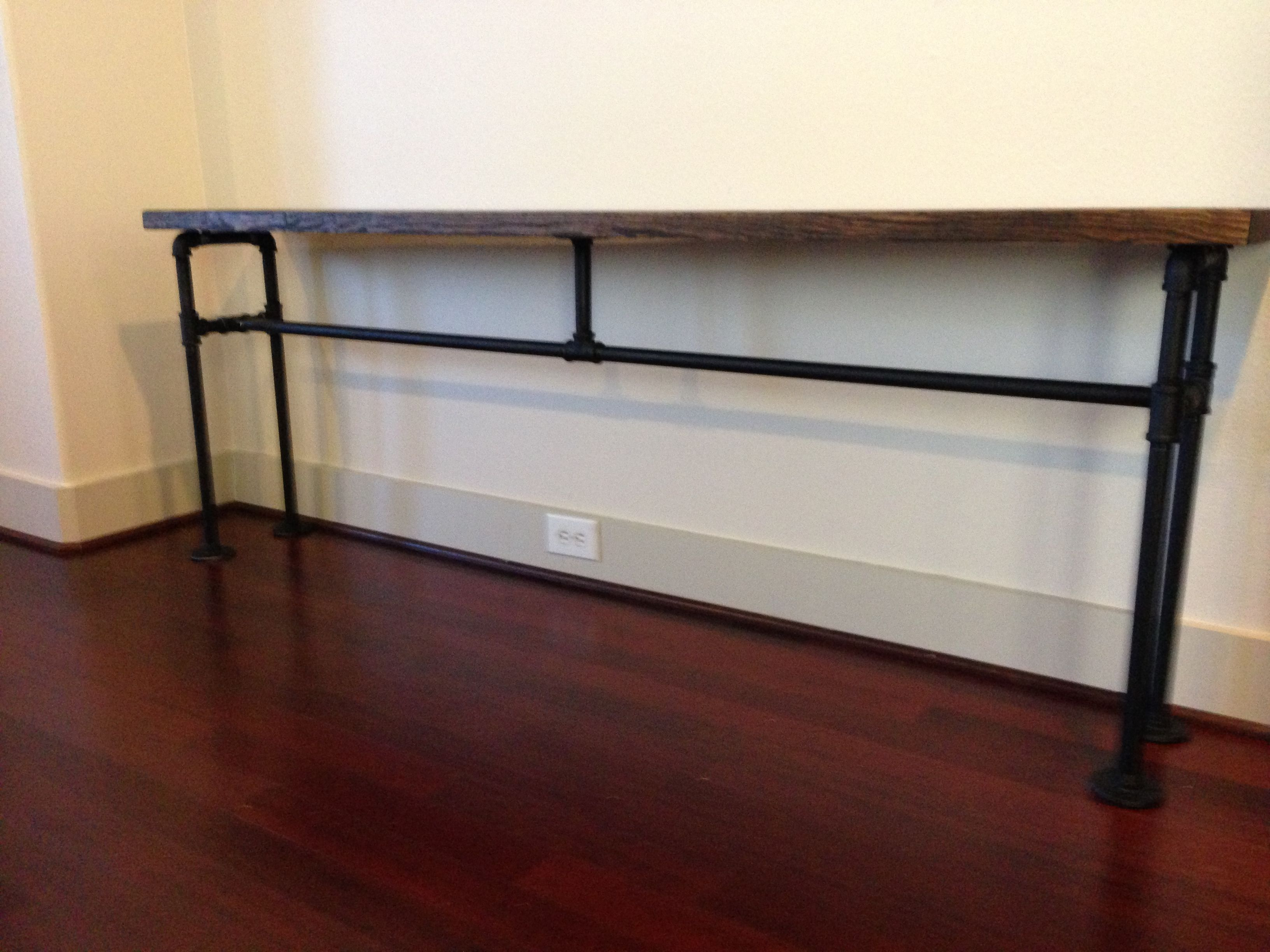 DIY console table from black plumbing pipe and wood all from Home