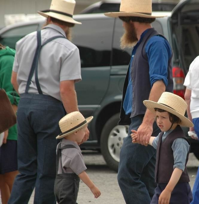 Differences; Old Order Amish Father And Son On Left, And