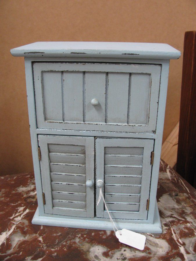 Gorgeous egg shell blue vintage style cupboard with draw in good condition.