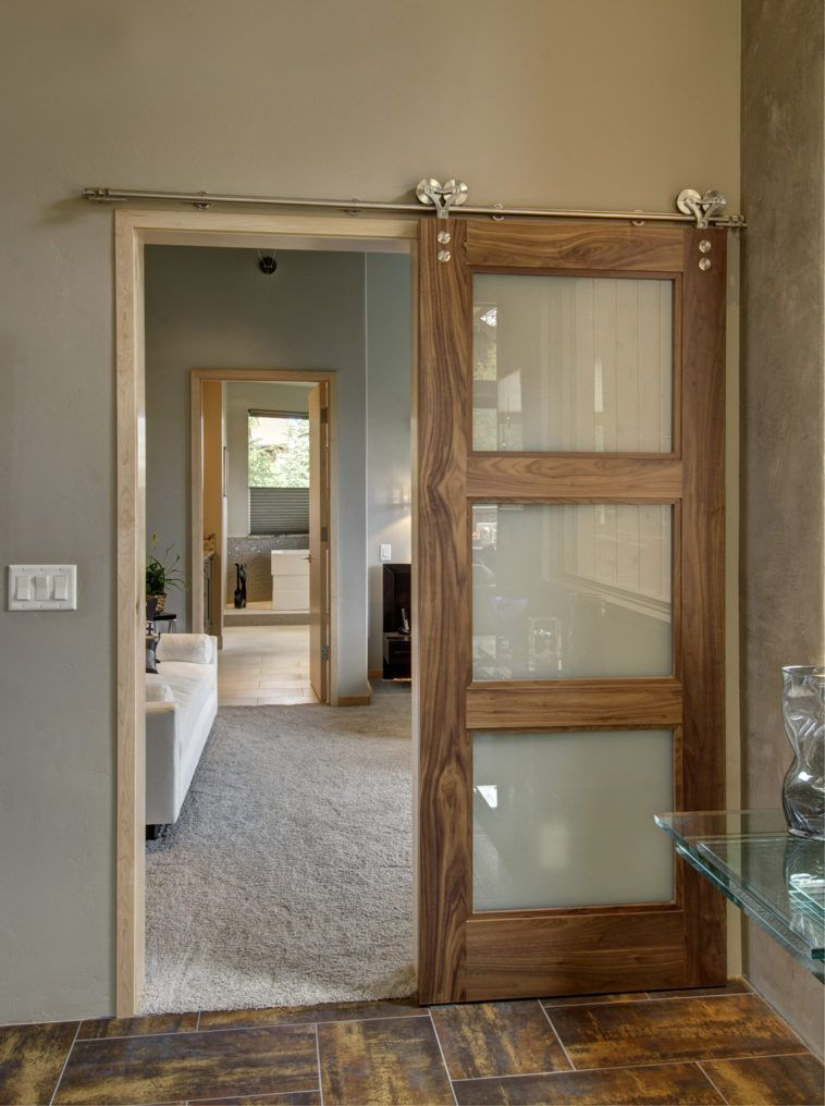 Sliding Clear Glass Barn Doors With Brown Wooden Frame And Silver Steel Track Railing On Grey Wall Glass Barn Doors Sliding Doors Interior Wood Doors Interior