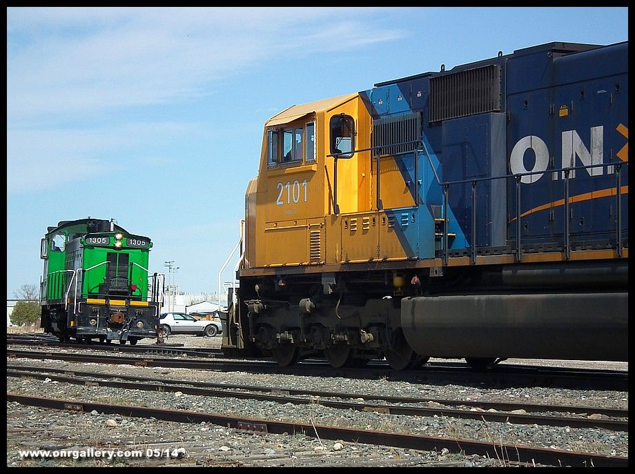 Northbound 213 feeds empty newsprint boxes to the awaiting Resolute Forest Products SW1200 1305 at Iroquois Falls May 14th.
