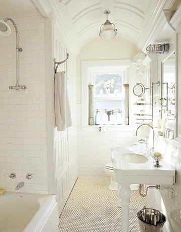 Small, narrow perfect bathroom with curved ceiling, penny tiles, Waterworks Belle Epoque Vitreous China Two Leg Single Console, polished nickel gooseneck faucet, subway tiles backsplash & shower surround and marine sconce.