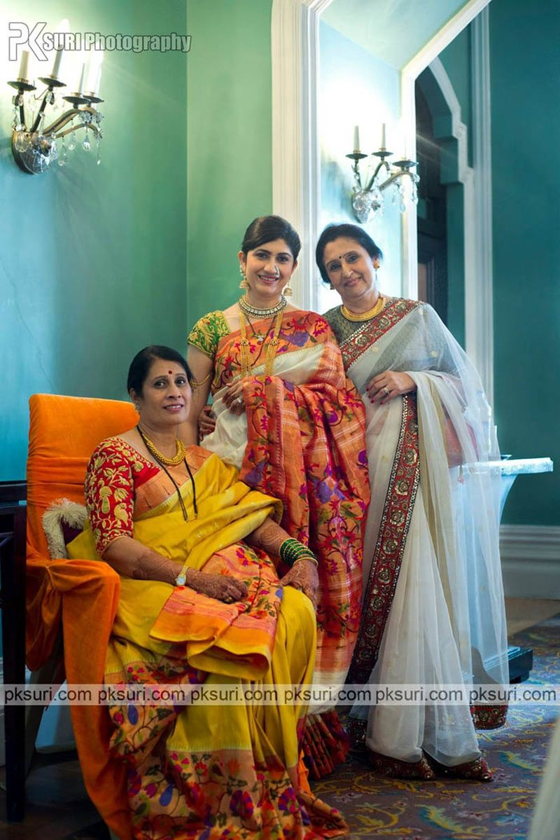fbb35b3de8 Family of the bride posing royally dressed in ethnic saree   Saree ...