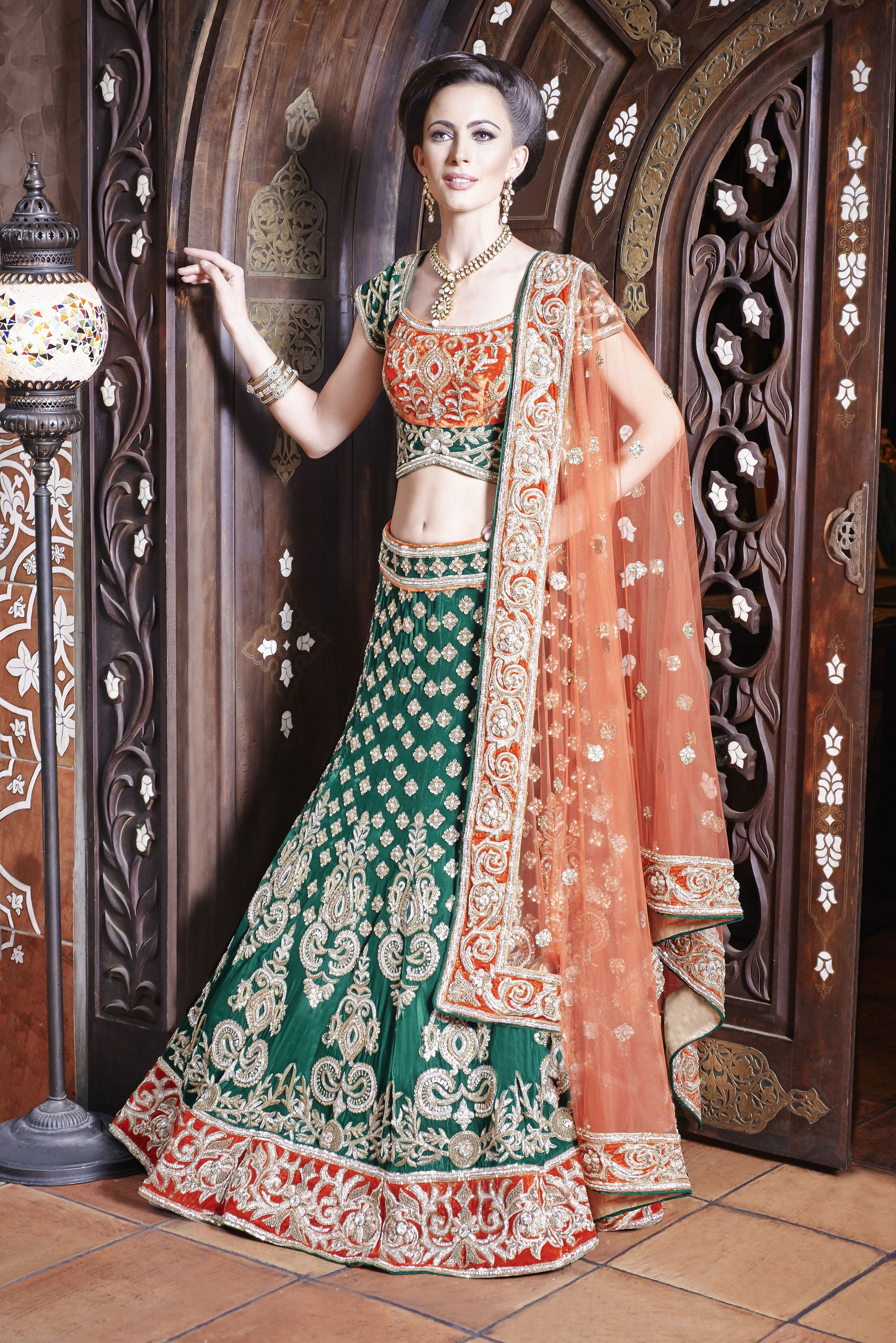 c89f82621c WG08 - emerald green Asian wedding outfit with a contrast orange velvet  blouse with a soft orange net dupatta