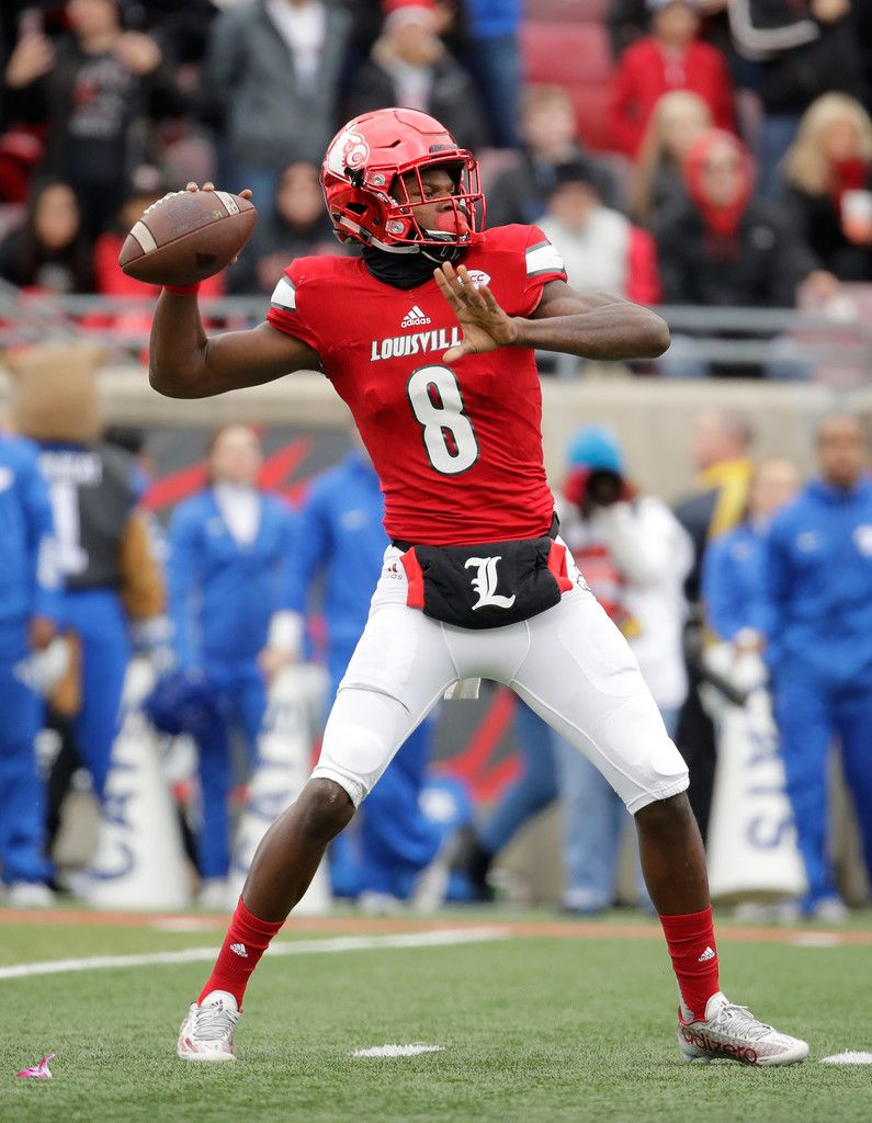 7eba4e1a0 Lamar Jackson Photos Photos - Lamar Jackson  8 of the Louisville Cardinals  throws a pass during the game against the Kentucky Wildcats at Papa John s  ...