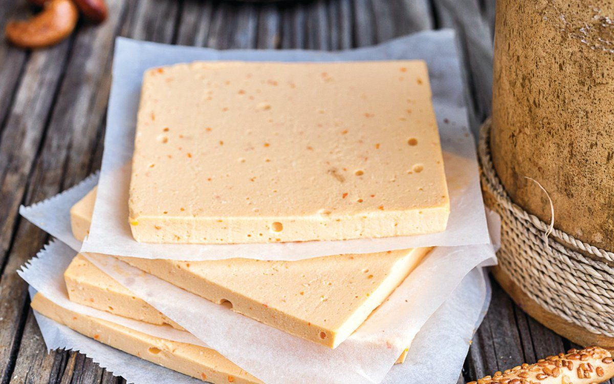 The Same Classic American Cheese Taste You Grew Up With Mild Firm And Satisfying This Creamy Gold American Cheese Slices Vegan Cheese Recipes Vegan Dishes