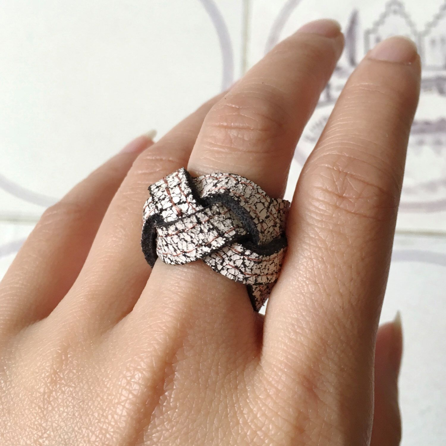 Pale Pink Crackle Leather Ring | Braided Ring | Wide Band Ring | Chunky Ring | White Statement Ring by ByLawLondon on Etsy https://www.etsy.com/uk/listing/469216721/pale-pink-crackle-leather-ring-braided