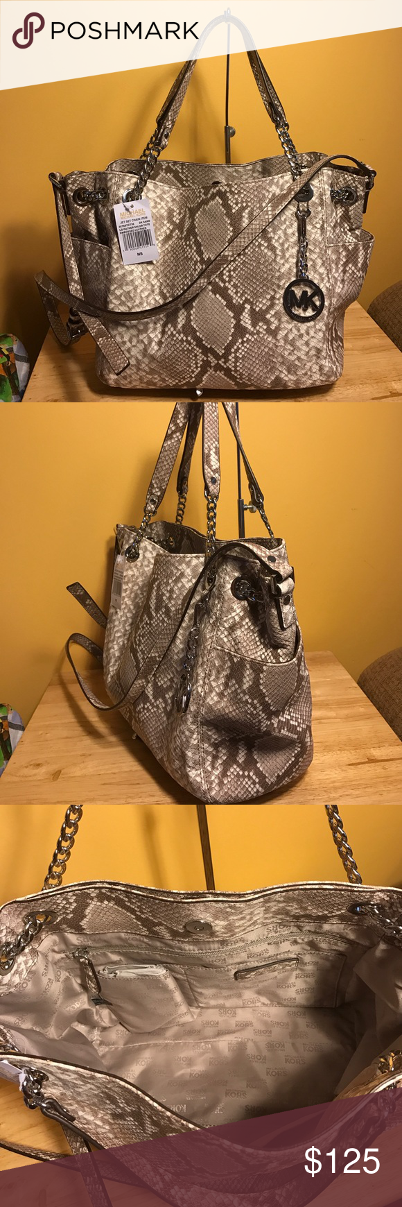"""New Michael kors large gathered dark sand tote Dark Sand python-embossed leather  * Silver tone hardware.  * Top handles with chain accents.  * Adjustable buckled shoulder strap.  * Cinched grommet sides.  * Removable MK logo circle charm.  * Approximate measurements: 16""""Lx 11""""h x 4""""D. Michael Kors Bags Totes"""