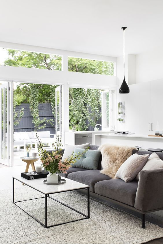 Neutral Living Room With Grey Sofa And Massive Windows Looks So Good With White Walls Coastal Living Rooms Home Mid Century Modern Living Room