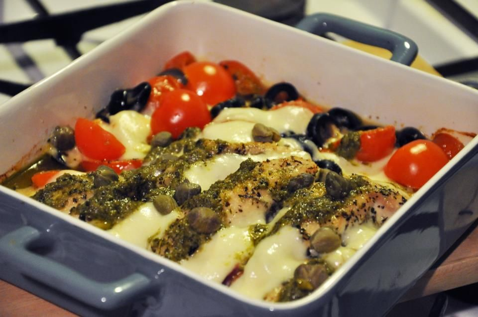 Roasted chicken with herbs with mozzarella, olives, capers and cherry tomatoes