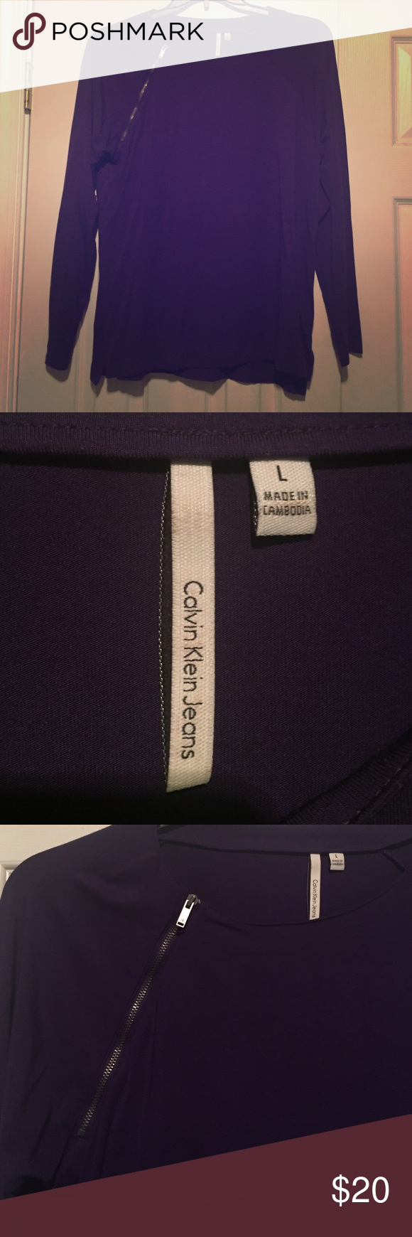 Calvin Klein Purple blouse Calvin Klein purple blouse with zipper embellishment on left front.  Worn only once. Calvin Klein Collection Tops Blouses