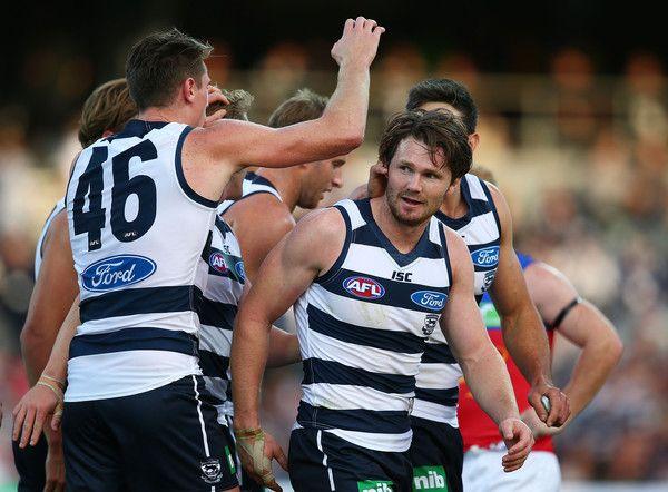 AFL Rd 3 - Geelong v Brisbane - Blitz congratulates + celebrates Danger's first goal at KP