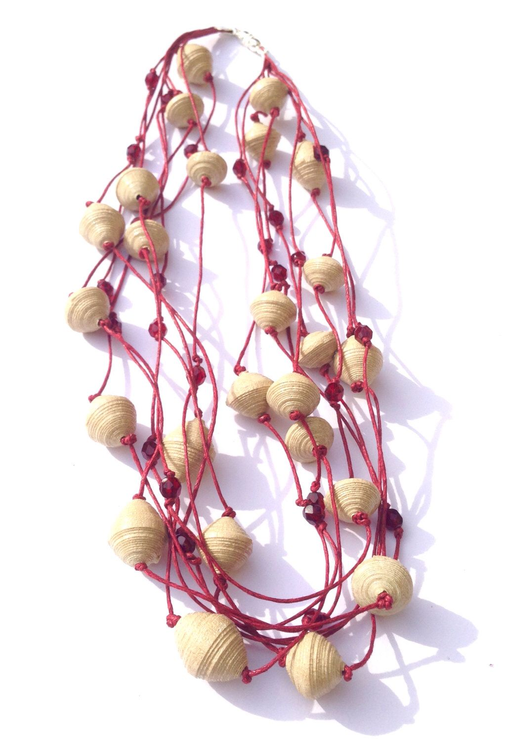 Paper necklace with red stand  Etsy https://www.etsy.com/it/listing/463871269/collana-rossa-a-piu-fili-con-perle-di