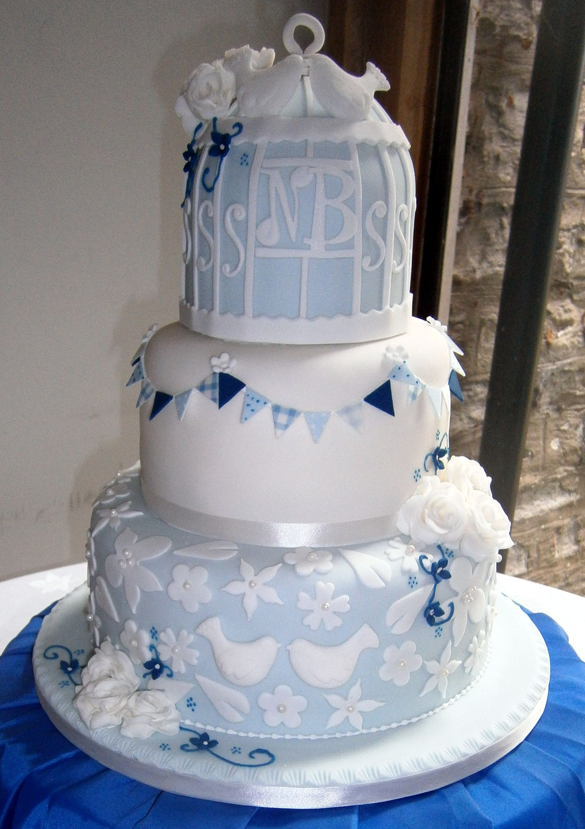 wedding cake silver and blue baby blue bunting bird cage wedding cake would this 24547