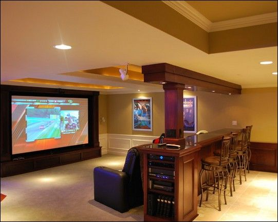 Rec room idea - Huge tv, sectional, and table and bar stools behind ...