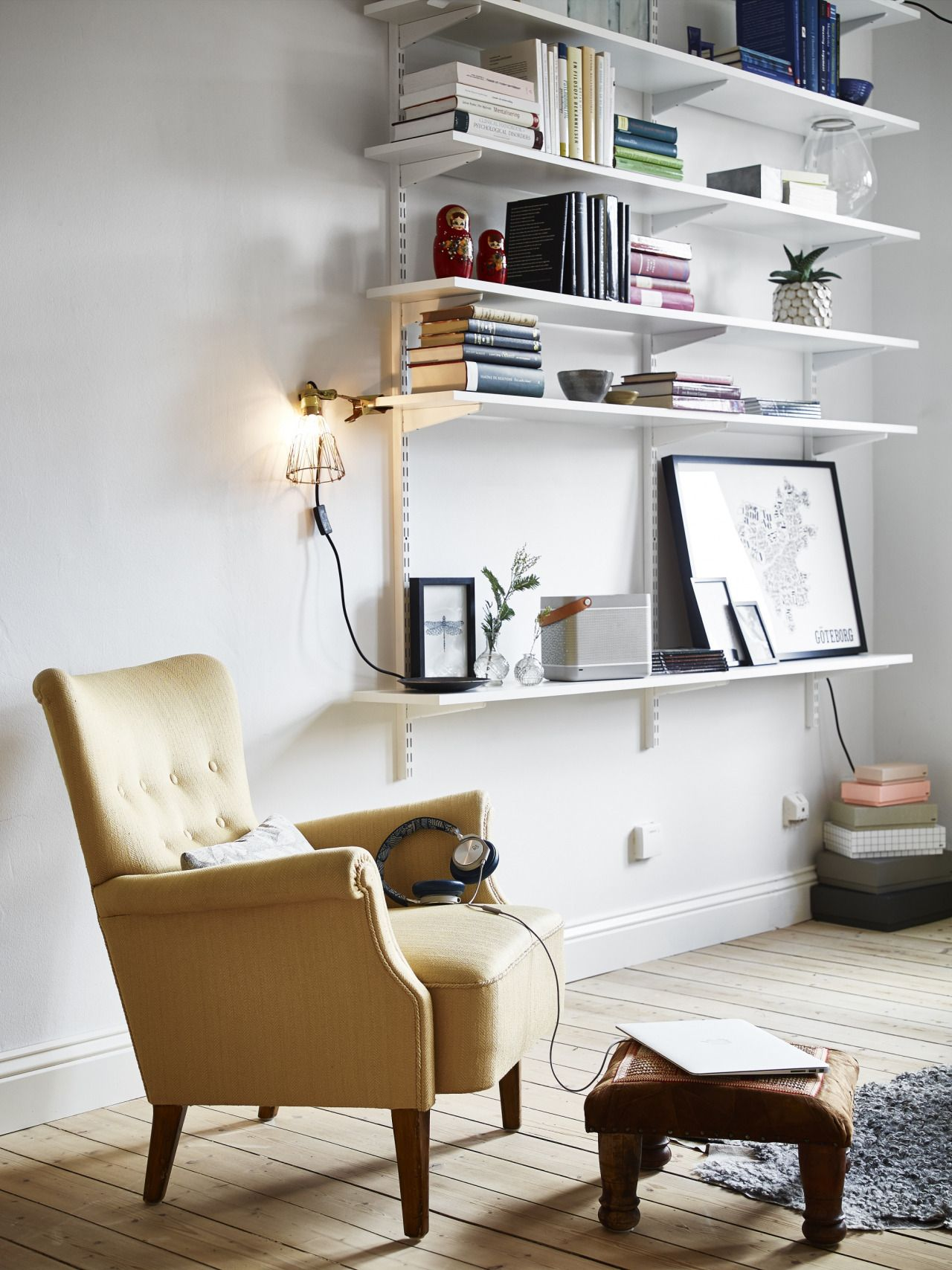Photo of wooden frames, raw bricks and a comfy yellow armchair / via Stadshem