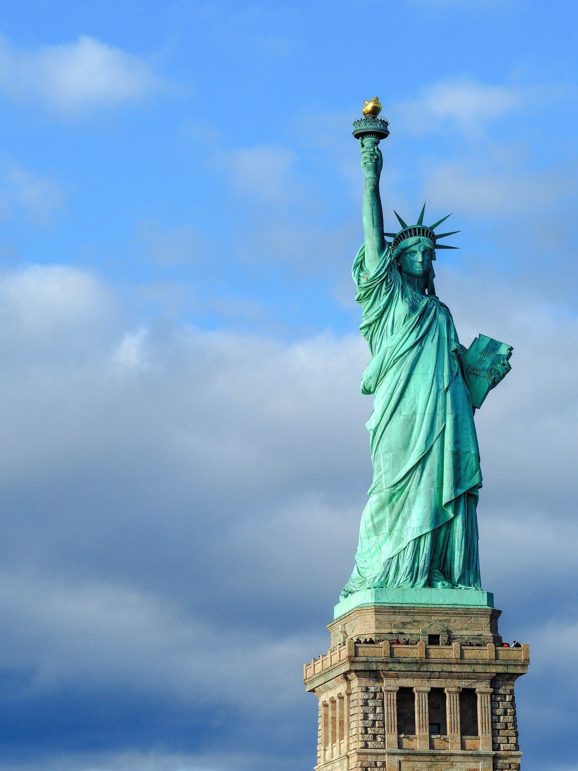 the Statue of Liberty New York City  front bridge park building state state building village manhattan center of liberty squareVisiting the Statue of Liberty New York Cit...