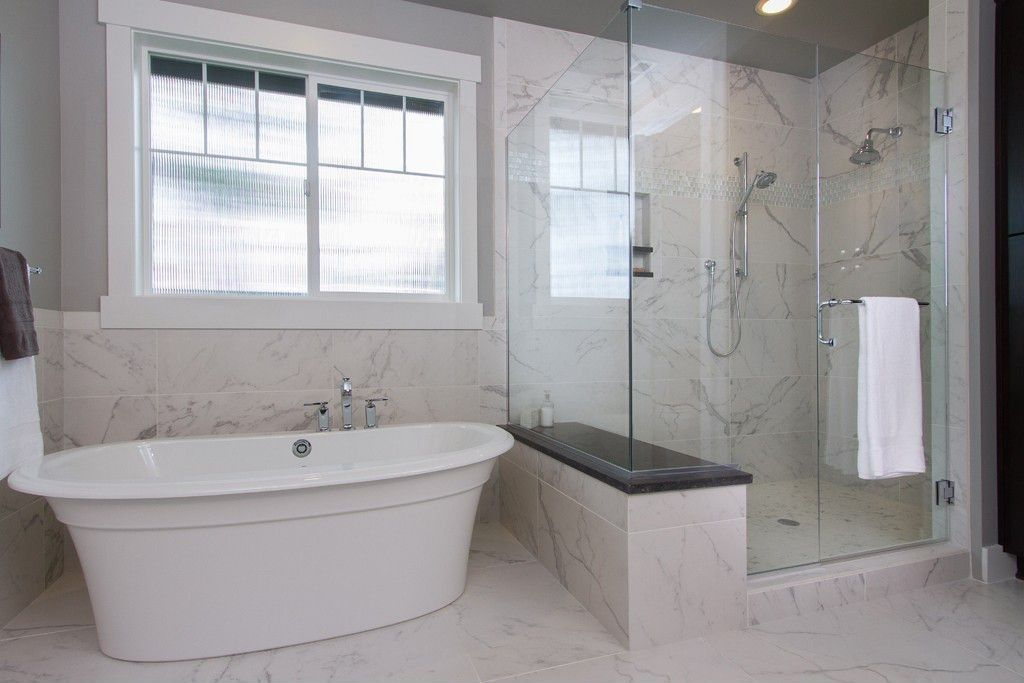 flooring ideas for small bathrooms%0A Traditional Master Bathroom with frameless showerdoor  Floor And Decor  Crema Marfil Polished Marble Tile  High ceiling