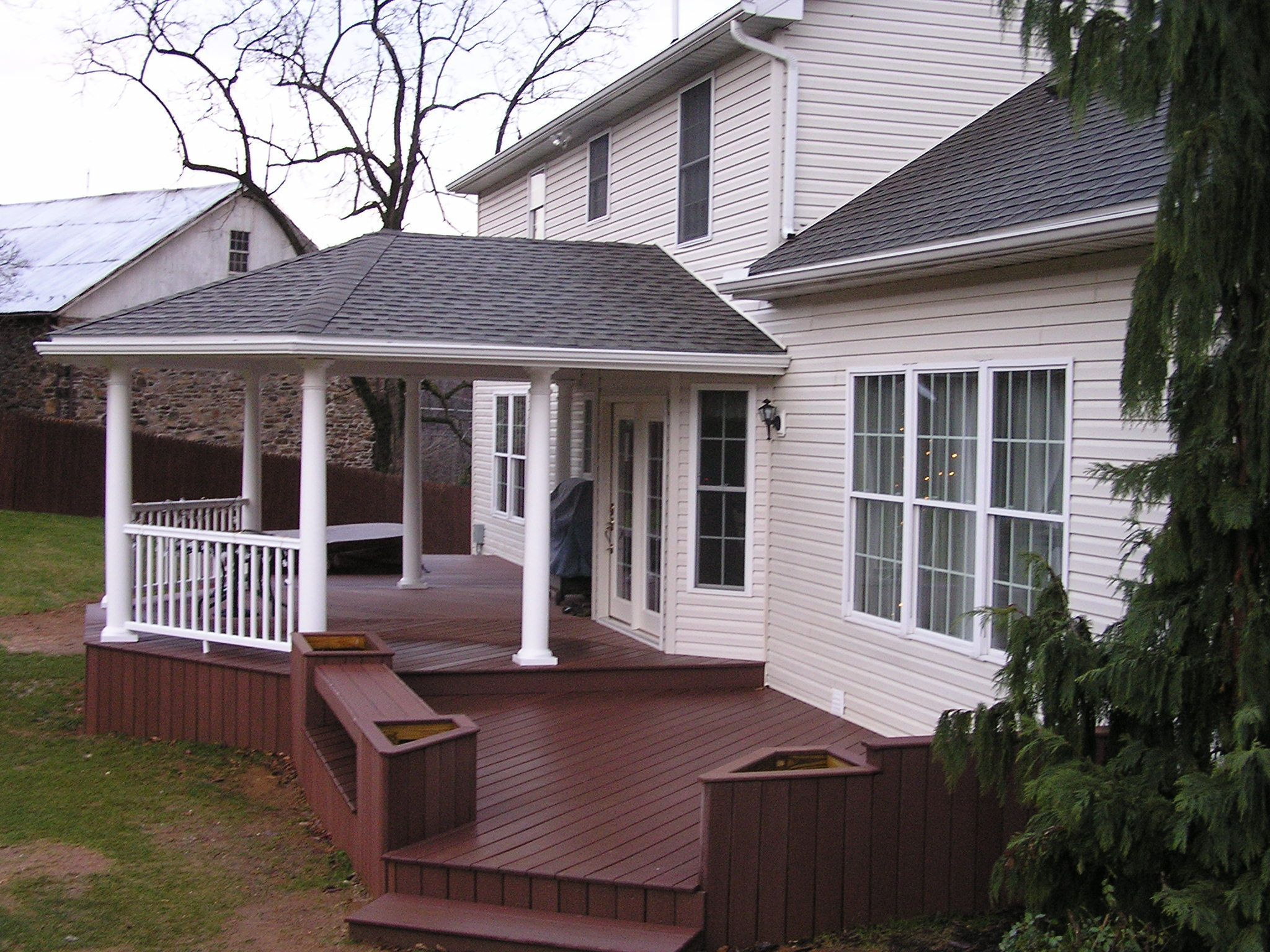 Covered Porch Deck With Built In Garden Planters