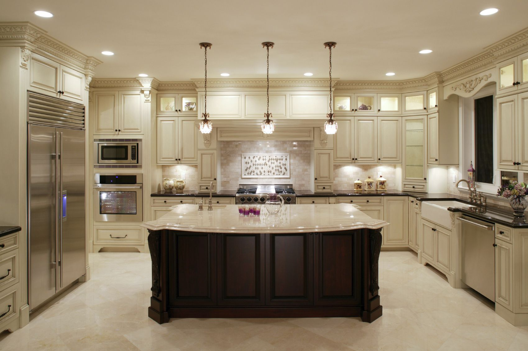 This U Shaped Kitchen Centers Around A Large Dark Wood Island With Classic  Marble Countertop. Surrounding Counters In Black, With White Cabinetry, ...