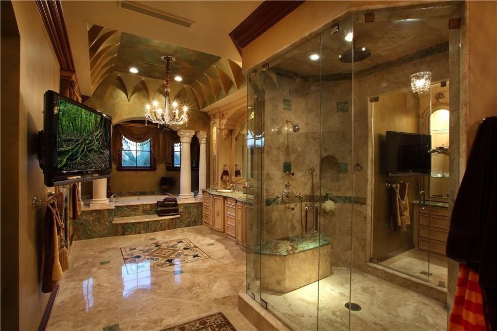 Luxury Master Bathroom Designs traditional master bathroom with chandelier, corinthian column