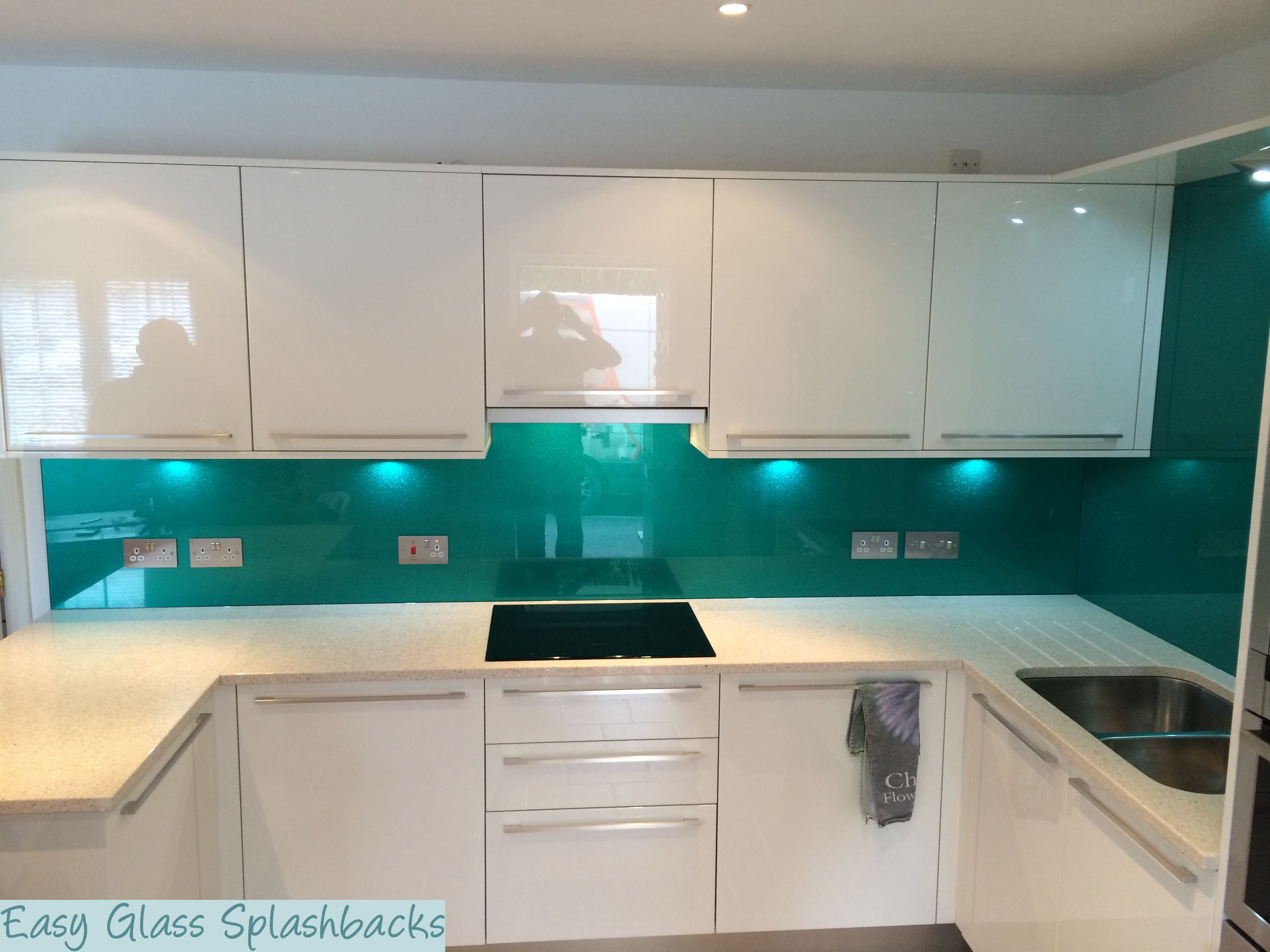 Kryponite Sparkly Green coloured glass splashback in a White Kitchen ...