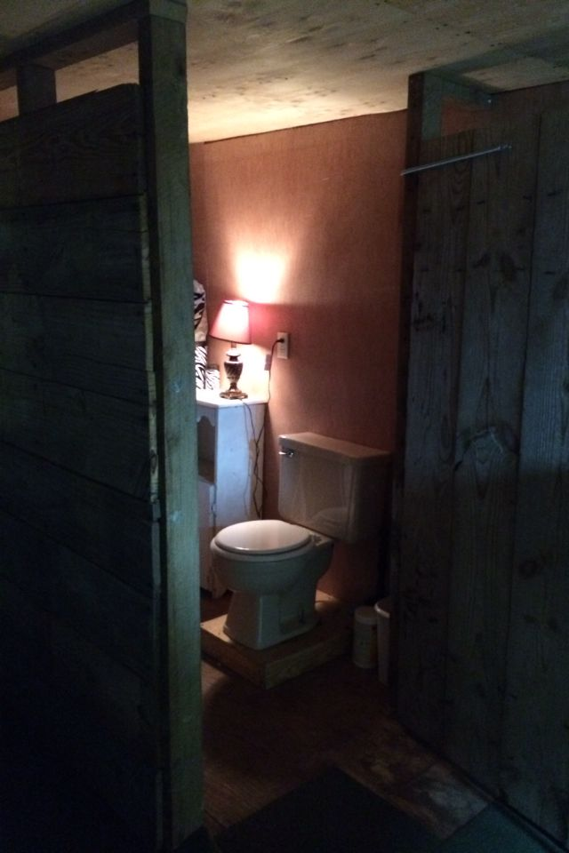 The inside of the rustic bathroom stall