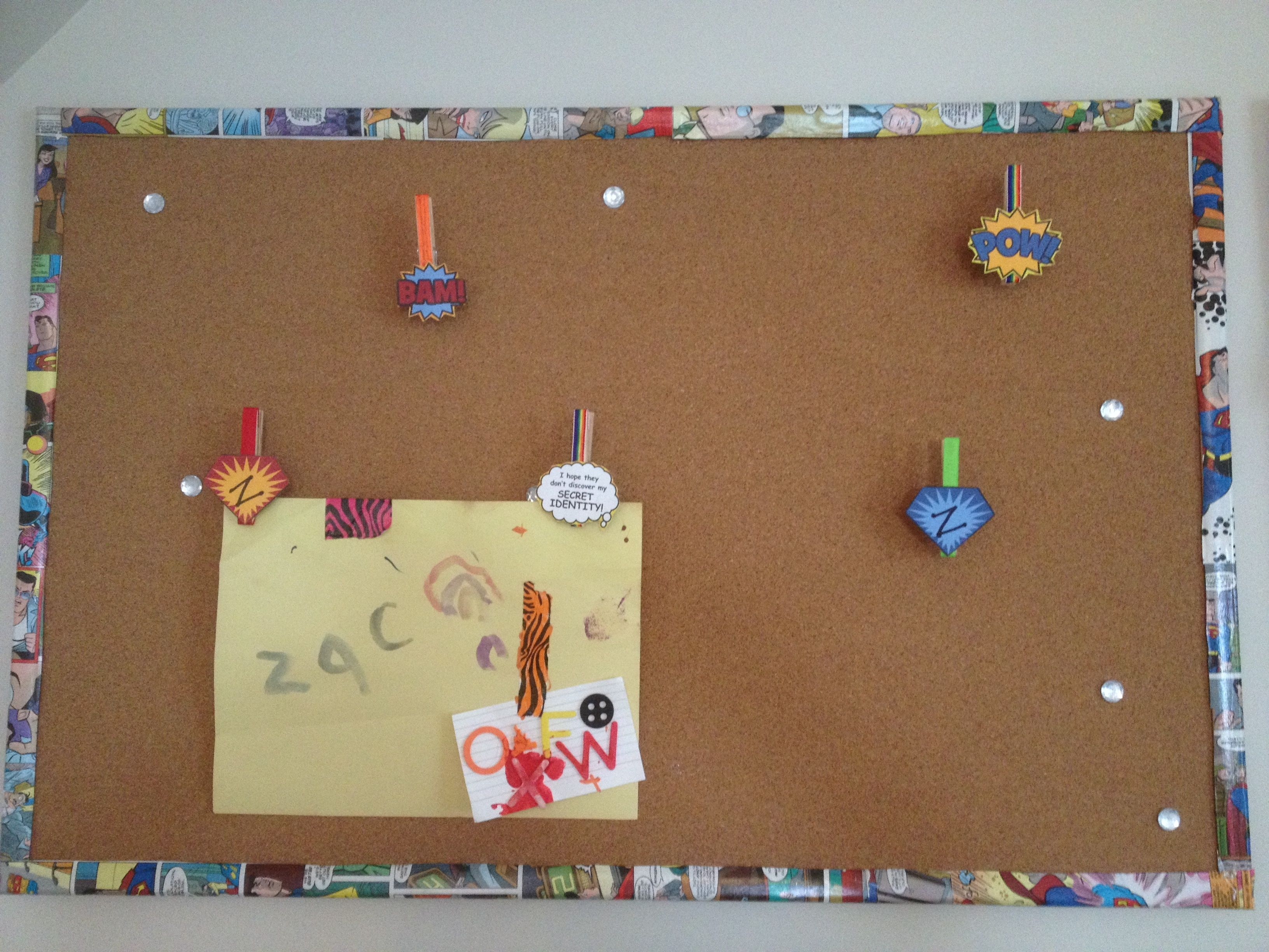 Diy superhero cork board and clips superhero bedroom for Diy bulletin board for bedroom