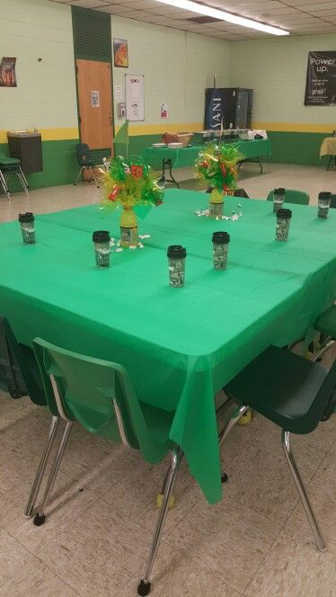 Table setting with kids and name of college sweatshirt over chair