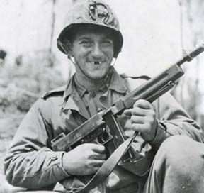 A smiling Marine poses with his M1928A1 Thompson on Okinawa