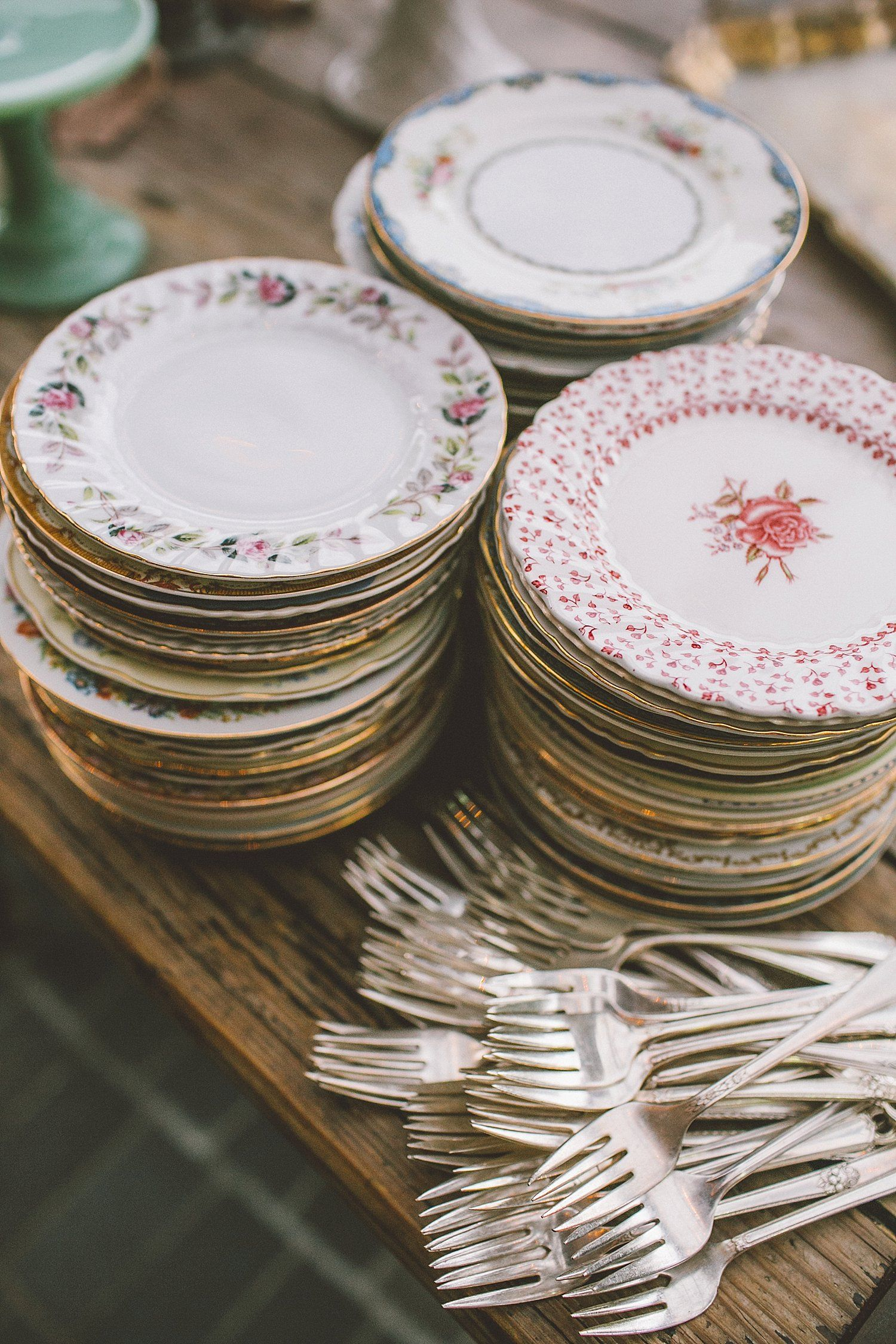 Mismatched dessert plates and silverplate forks collected from flea markets. For a party buffet & Tiato wedding | Party buffet Buffet and Reception
