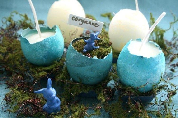 bemalte Ostereier werden zu Kerzen und Tischkarten