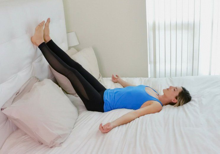 10 Sleep Promoting Yoga Poses You Can Do Right In Bed Night Time Yoga Yoga Poses Relaxing Yoga