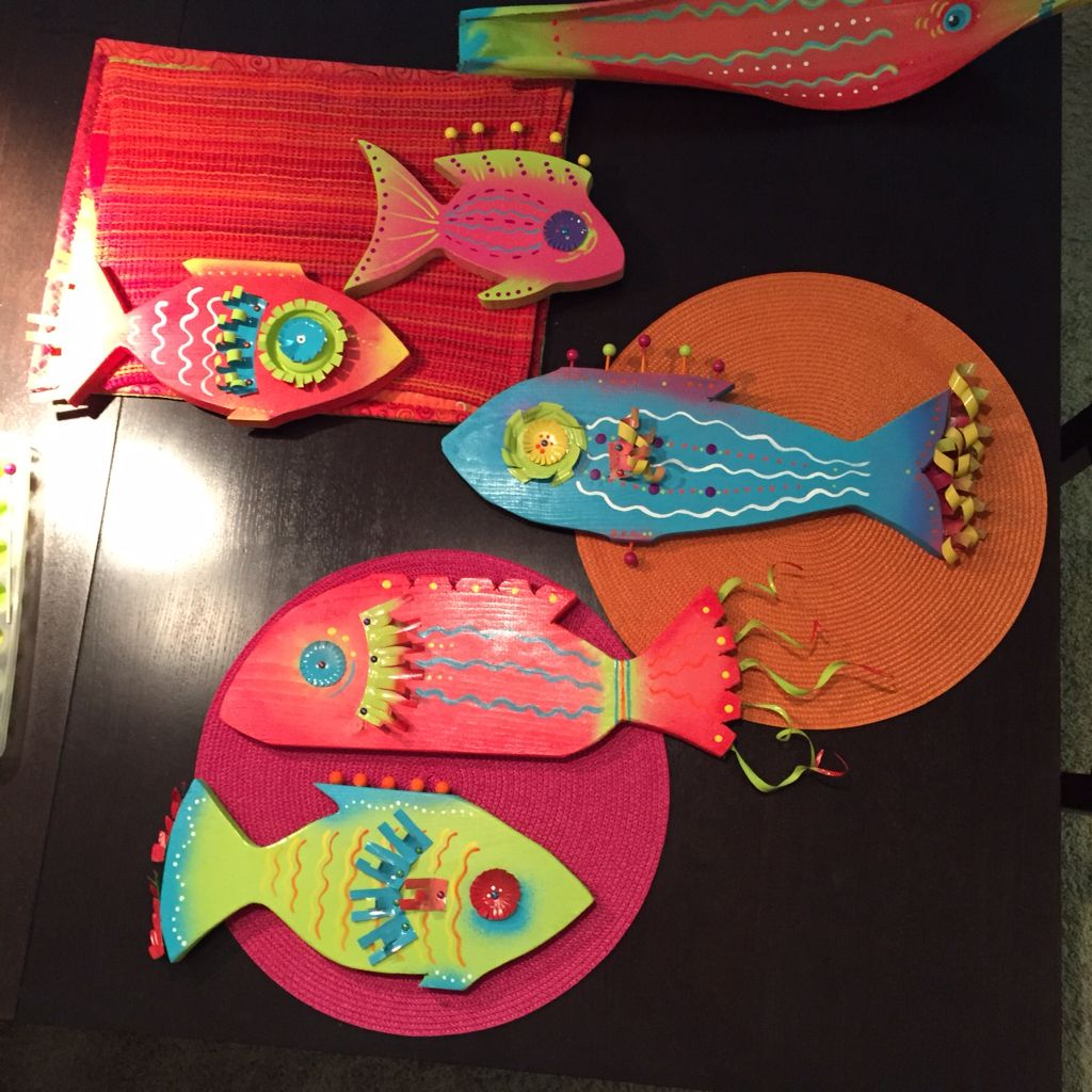 Fish made out of wood, dog food cans, soda cans & paint
