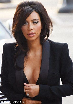Kim Kardashian Ditches Wedding Bling For Tribute To North West