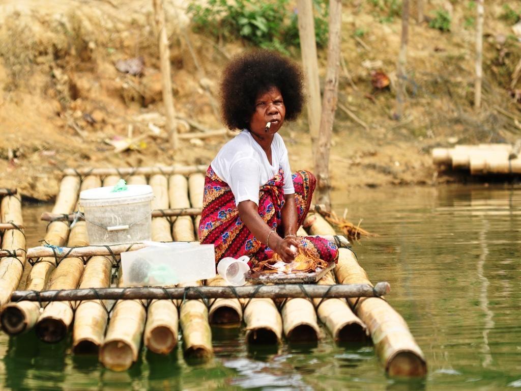 Batek People: Orang Asli Women Washing At Royal Belum National Park